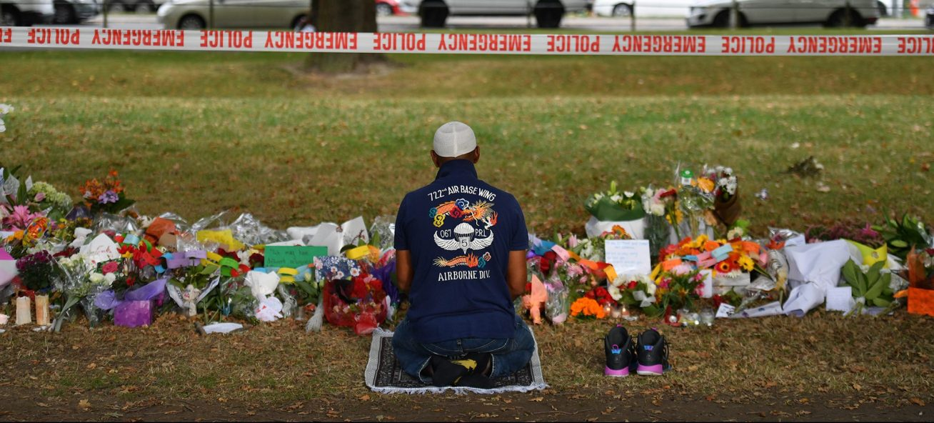 A Muslim worshipper prays at a makeshift memorial at the Al Noor Mosque on Deans Road, Christchurch, New Zealand, after a gunman killed 50 worshippers at the Al Noor Masjid and Linwood Masjid.